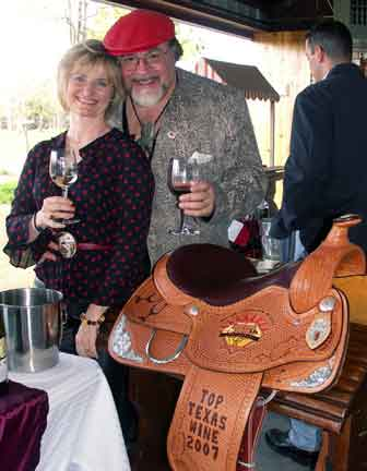 Paul & Merrill with Houston Rodeo Competition Wine Award Saddle